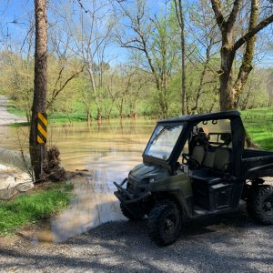 Ranger at flooded low water bridge at Copper Creek